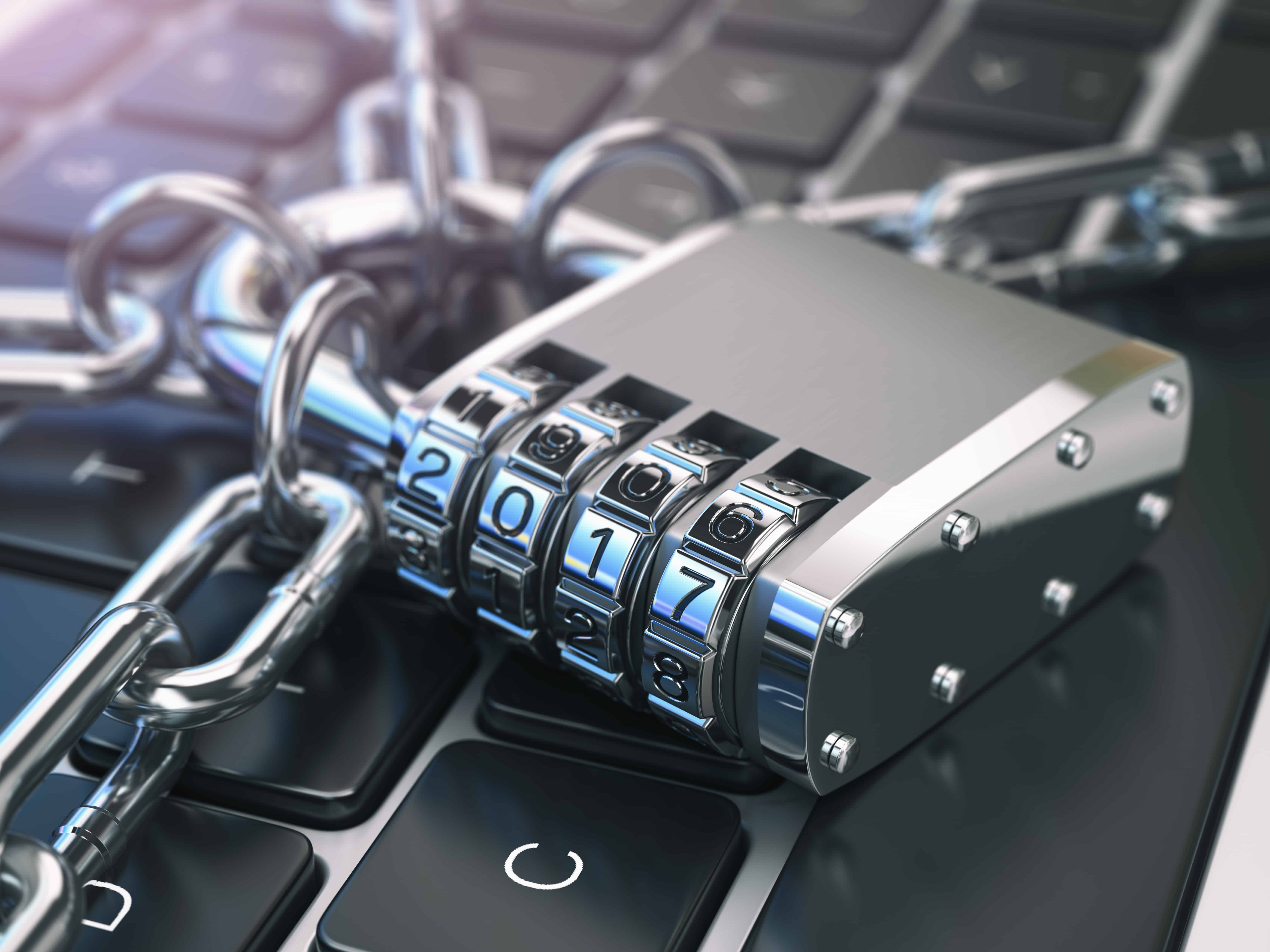 Padlock and chains around computer