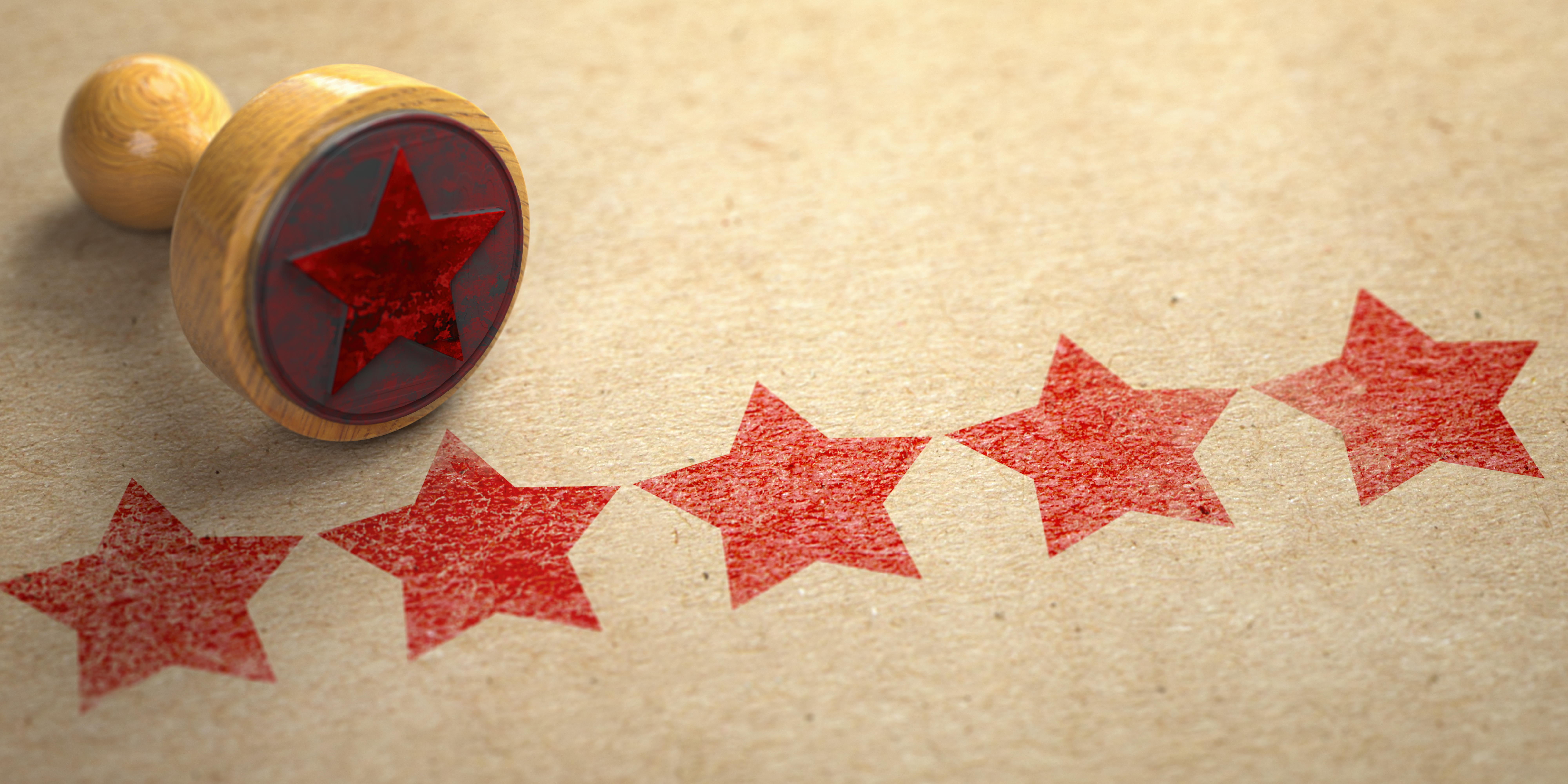 Five stars printed on craft paper with stamp.